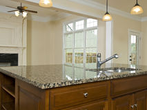 Luxury Home Kitchen granite island countertop Royalty Free Stock Photography