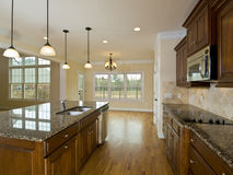 Luxury Home Kitchen with Hanging Lights Royalty Free Stock Photos