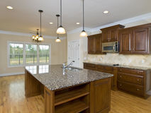 Luxury Home Kitchen Hanging Lights and island Royalty Free Stock Image