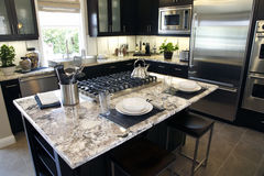 Luxury home kitchen island Royalty Free Stock Photography