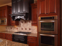 Luxury Home kitchen two tone wood Stock Image