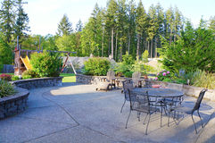 Luxury home large back yard with furniture Royalty Free Stock Image