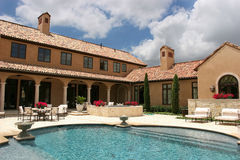Luxury home looking over the pool stock image