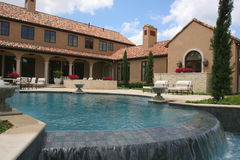 Luxury home looking over the pool Stock Photography