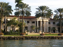 Luxury home in Miami. A view of a luxurious mansion seen here on Star and Palm Islands in the city of Miami in the state of Florida in the U.S.A. Viewed from the royalty free stock image