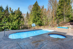 Luxury home pool and jacuzzi. Royalty Free Stock Photo