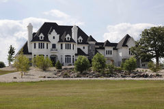 Luxury home with stone landscaping Royalty Free Stock Photos