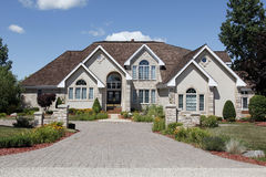 Luxury home with stone pillars Stock Photography