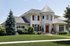 Luxury home with stone turret Royalty Free Stock Photography