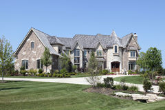 Luxury home with stone turret Royalty Free Stock Photos