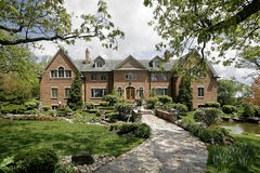Luxury home with stone walkway. Large brick home with stone walkway and landscaping Stock Images