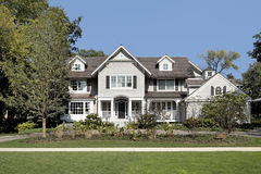 Luxury home in suburbs. With circular driveway Royalty Free Stock Image