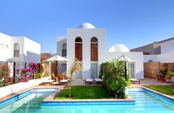 Luxury home with swimming pool. Royalty Free Stock Images