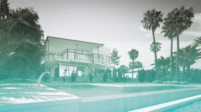 Luxury Home with Swimming Pool and Palm Trees. Exterior of Luxury Home - Rear View from Back Yard Showing In-Ground Swimming Pool, Palm Trees, and Two Storey Stock Images