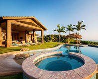 Luxury home with swimming pool Stock Images