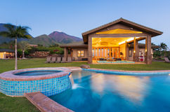Luxury home with swimming pool. At sunset Stock Photography