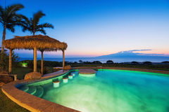 Luxury home with swimming pool. At sunset Stock Images