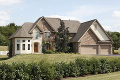 Luxury home with three car garage Stock Images