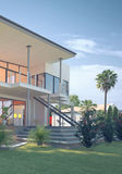 Luxury Home with Tropical Garden and Glass Balcony. Architectural Detail of Exterior of Luxury Two-Storey Home with Glass Balconies - View from Back Yard Showing stock images