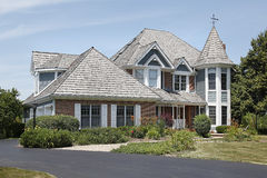 Luxury home with turret Royalty Free Stock Photo