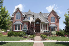 Luxury home with turret and arched entry Stock Photography
