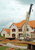 Luxury Home Under Construction 3. A large home being constructed with a crane Royalty Free Stock Images
