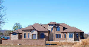 Luxury Home Under Construction 5. Brick covered luxury home under construction Royalty Free Stock Images