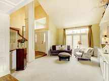 Luxury home well decorated golden living room with beige carpet. Stock Photo