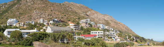 Luxury homes against the Hottentots Holland Mountains in Gordons. GORDONS BAY, SOUTH AFRICA - MARCH 29, 2017:  Luxury homes against the Hottentots Holland Royalty Free Stock Photography