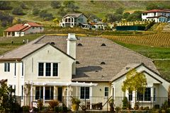 Luxury homes on hillside. A group of luxury homes in the hills of a golf course stock photography