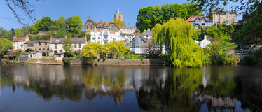 Luxury homes on river bank, Knaresborough, England. Panoramic view on caste and village on the bank of river Nidd in Knaresborough, taken in bright summer Royalty Free Stock Photography