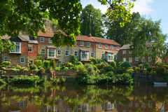Luxury homes on river bank, Knaresborough, England. Luxury residence on the bank of river Nidd in Knaresborough, taken in bright summer sunlight in the Mother Royalty Free Stock Photos