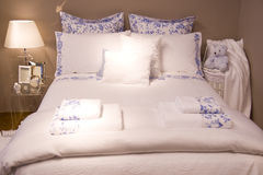 Luxury hotel. Room interior with white bed Royalty Free Stock Photo