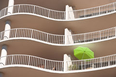 Luxury Hotel. A green umbrella on a balcony of a hotel Royalty Free Stock Photo