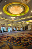 Luxury hotel banquet hall. A luxury hotel banquet hall with thick flannelet carpet and big round pendent lamp Stock Images