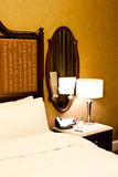 Luxury hotel bedroom Stock Images