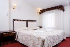 Luxury hotel bedroom Stock Photos