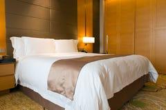 Luxury hotel bedroom Stock Images