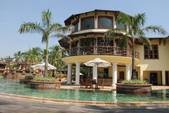 Luxury Hotel in Goa, India. Here everything: beautiful bungalows, waterfalls, palm trees, lawn. Asia Stock Image