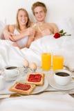 Luxury hotel honeymoon breakfast - couple in bed Stock Photo