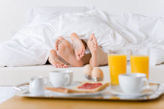 Luxury hotel honeymoon breakfast - couple in bed Stock Images