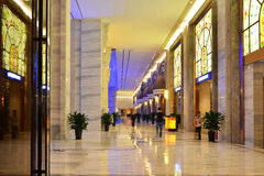 Luxury hotel lobby. Decorated with marble floor tile, color pattern glass and led light Stock Image