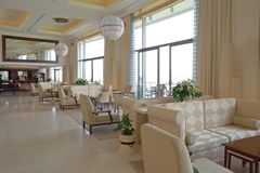Luxury Hotel Lounge. Bright view of a spacious airy lobby lounge in a 5-star hotel stock photo