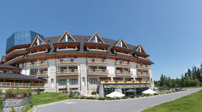 Luxury hotel in mountains. Stock Photo