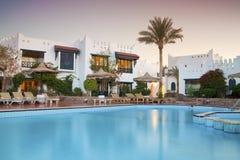 Luxury hotel pool. Beautiful Resort Pool on evening Royalty Free Stock Photo
