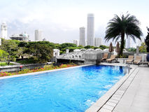 Luxury hotel pool, city view Royalty Free Stock Photos