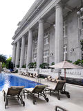 Luxury hotel pool, loungers Royalty Free Stock Image