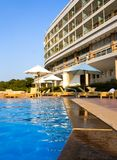 Luxury Hotel Poolside. Vertical, blue sky Royalty Free Stock Photography