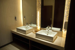 Luxury hotel public toilet. The interior of a luxury hotel public toilet Royalty Free Stock Photography