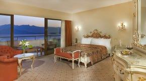 Luxury hotel room. Snacks and glass of wine stock photos
